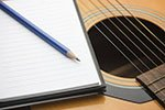 Writing Pad and Guitar